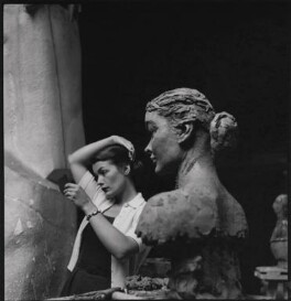 Nancy Rogers with her bust by Sir Jacob Epstein, by Ida Kar - NPG x136759