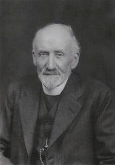 John Wood Oman, by Walter Stoneman, 1938 - NPG x186934 - © National Portrait Gallery, London
