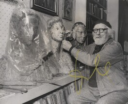 Augustus John working on a bust of his daughter Poppet, by P.A. Reuter Photos Ltd - NPG x139596