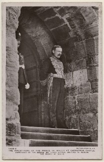 'The investiture of the Prince of Wales at Carnarvon Castle. Constable of the Castle Mr Lloyd George waiting to receive the Prince of Wales', published by Rotary Photographic Co Ltd - NPG x197630