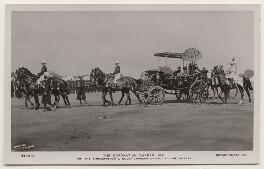 'The Coronation Durbar, 1911. T.M. The King-Emperor & Queen-Empress Driving to the Durbar', by Ernest Brooks, published by  Rotary Photographic Co Ltd - NPG x193183