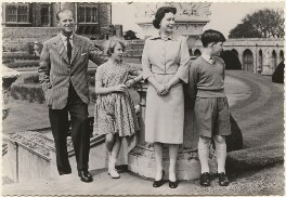 'H.M. The Queen with her family in the East Terrace Garden, Windsor Castle' (Prince Philip, Duke of Edinburgh; Princess Anne; Queen Elizabeth II; Prince Charles), published by James Valentine & Sons Ltd - NPG x193034