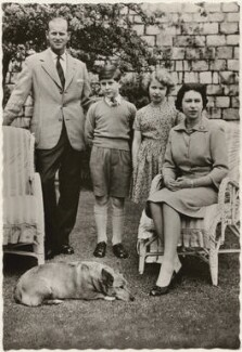 'H.M. The Queen with her family in Windsor Castle gardens' (Prince Philip, Duke of Edinburgh; Prince Charles; Princess Anne; Queen Elizabeth II), published by James Valentine & Sons Ltd - NPG x193035