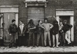 UB40 (Norman Hassan; Robin Campbell; Astro; Ali Campbell; Earl Falconer; Mickey Virtue; James ('Jimmy') Brown; Brian Travers), by Terry Smith - NPG x199429