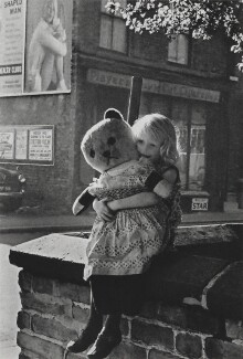 Girl with Teddy Bear, Moss Side, Manchester, by Sefton Samuels - NPG x199716