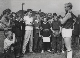 Bobby Moore meeting young fans, by Reg Speller, for  Fox Photos Ltd - NPG x199764