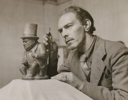 C. Tim Brown sculpting a Winston Churchill Toby jug, by Central Press - NPG x200104