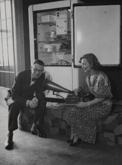 Henry Hall and Florence Desmond with the new 'HMV' gramaphone refridgerator, by Harold Tomlin, for  Daily Herald - NPG x182411