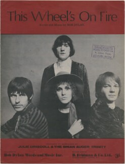 Sheet music cover for 'This Wheel's On Fire' by Julie Driscoll and the Brian Auger Trinity (Julie Driscoll (later Tippetts); Clive Thacker; Brian Auger; David ('Dave') Ambrose), published by Bob Dylan Words and Music Inc, after  Unknown photographer - NPG D48387