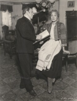 Sir John Lavery and Marlene Dietrich in costume as Anna Sedlak on the set of 'I Loved a Soldier', for Paramount Productions Inc. - NPG x194400