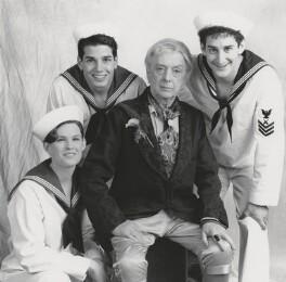 Quentin Crisp (Dennis Charles Pratt) with three unknown people, by Ken Regan - NPG x194419