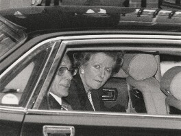 Margaret Thatcher and Sir Denis Thatcher, 1st Bt leaving 10 Downing Street, by Ken Lennox, for  Daily Mirror - NPG x198324