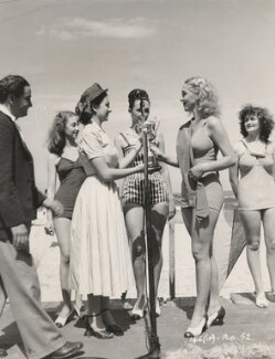 Jean Simmons presenting a trophy to the winner of a bathing beauty competition, by Unknown photographer - NPG x198391