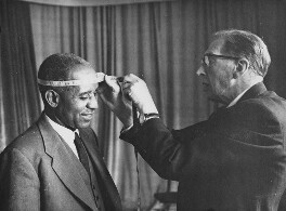 Hastings Kamuzu Banda having his head measured for a wax model by Bernard Tussaud, by Unknown photographer - NPG x198396