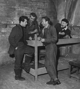 Bryan Forbes, Sir Christopher George Rhodes, 3rd Bt, Sir John Mills and Lionel Charles Jeffries during filming of 'The Colditz Story', by Allen Newton - NPG x198422