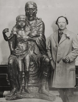 Jacob Epstein with his bronze sculpture of the 'Madonna and Child', by Unknown photographer - NPG x196120
