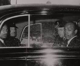 John Arthur Alexander ('Johnny') Edgecombe and Aloysius ('Lucky') Gordon with policemen, by Unknown photographer, 10 July 1963 - NPG  - © reserved; collection National Portrait Gallery, London
