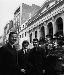 Brian Epstein with The Fourmost (Brian O'Hara; Michael ('Mike') Millward; David ('Dave') Lovelady; William ('Billy') Hatton), by Lewis Morley, mid 1960s - NPG  - © Lewis Morley Archive