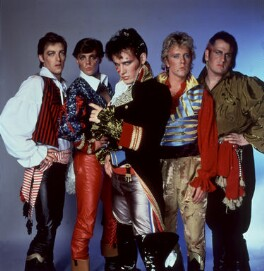 Adam and the Ants (Merrick (Chris Hughes); Terry Lee Miall; Adam Ant; Gary Tibbs; Marco Pirroni), by Allan Ballard - NPG x125374