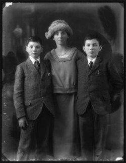 Stephen Behrens Cohen; Hannah Mildred ('Nina') (née Behrens), Lady Cohen; Nigel Benjamin Cohen, by Bassano Ltd - NPG x122255