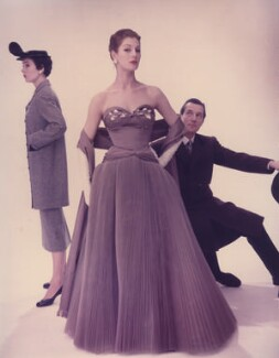 Sir Hardy Amies with two fashion models including Fiona (née Campbell-Walter), Baroness Thyssen, by Norman Parkinson, 1953 - NPG x30059 - © Norman Parkinson Archive