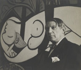 Pablo Picasso with his painting of Marie Thérèse Walter (1932 Nude, Green Leaves and Bust), by Cecil Beaton, 1933 - NPG x40326 - © Cecil Beaton Studio Archive, Sotheby's London