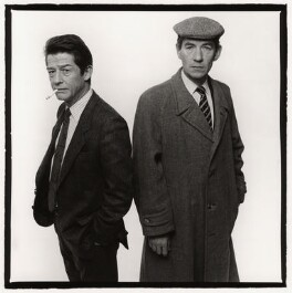 Sir John Hurt as 'Stephen Ward' and Ian McKellen as 'John Profumo' in 'Scandal', by Trevor Leighton, 10 December 1988 - NPG x35320 - © Trevor Leighton / National Portrait Gallery, London