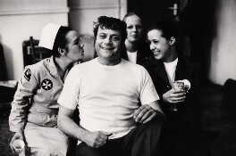 Oliver Reed and three unknown women, by Johnny Dewe-Mathews - NPG x16142