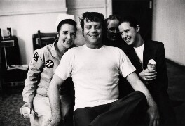 Oliver Reed and three unknown women, by Johnny Dewe-Mathews - NPG x16141