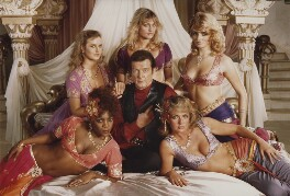 Roger Moore as James Bond with the Bond Girls in 'Octopussy', by Frank Connor - NPG x76208