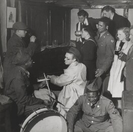 Carl Ronald Giles with his wife Sylvia ('Joan') Clarke and musicians, including Butch Shepherd, by Lee Miller - NPG P1078