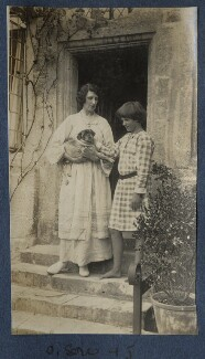 Lady Ottoline Morrell with her pug Soie; Julian Vinogradoff (née Morrell), possibly by Philip Edward Morrell - NPG Ax140639