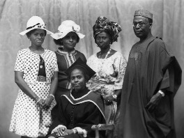 Hannah Idowu Dideolu Awolowo (née Adelana) and Obafemi Awolowo with their family, by Bassano Ltd - NPG x171545
