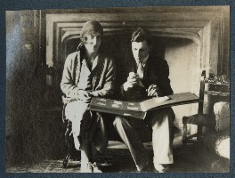 'Va and Billy looking at his photographs', by Lady Ottoline Morrell - NPG Ax142088