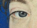 Small dots of blue have been applied to the p…