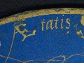 Detail of the carefully painted inscription i…