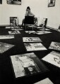 Ida Kar hanging her Cuba show at Hamiltons Gallery, by R. Chowen, for  Evening Standard - NPG x132374