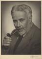 Cyril Edwin Mitchinson Joad, by William Flower, for  Elliott & Fry - NPG x13939