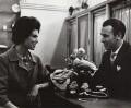 Clive John Allen with a customer (The Burlington Arcade), by Ida Kar - NPG x134358