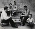 'Playing backgammon in the courtyard near their homes in Yerevan', by Ida Kar - NPG x135020