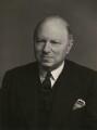 Sir John Elliot (né John Elliot Blumenfeld), by Walter Stoneman - NPG x167378