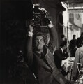 Roger Moore, by Bob Collins - NPG x136441