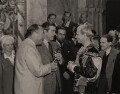 Hal Wallis and Ray Milland present Laurence Olivier with the Academy Award for 'Henry V' on the set of 'Hamlet', by Unknown photographer - NPG x137986