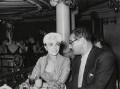 Joan Collins; Theo Cowan, by John Heddon - NPG x194351