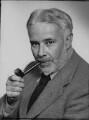 Cyril Edwin Mitchinson Joad, by William Flower, for  Elliott & Fry - NPG x81895